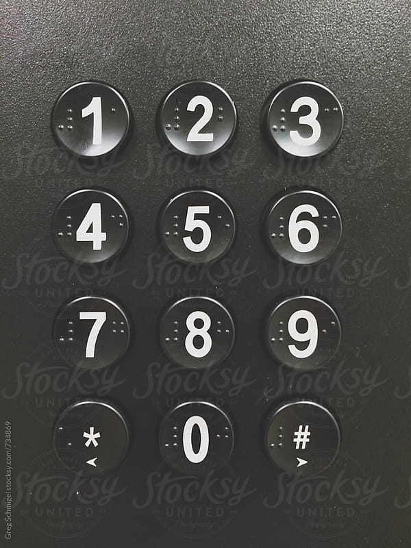 Numbered push buttons on a vending machine with braille letters by Greg Schmigel for Stocksy United
