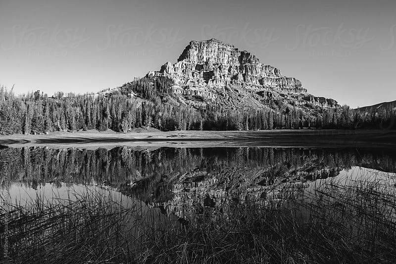 Mountain and reflection in pond in Wyoming wilderness by Matthew Spaulding for Stocksy United