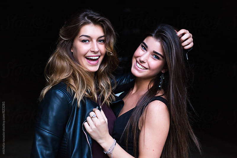 Two smiling young woman looking at camera by michela ravasio for Stocksy United