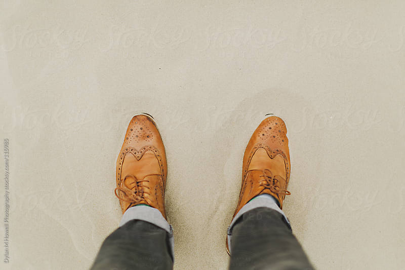 wingtips on the beach by Dylan M Howell Photography for Stocksy United