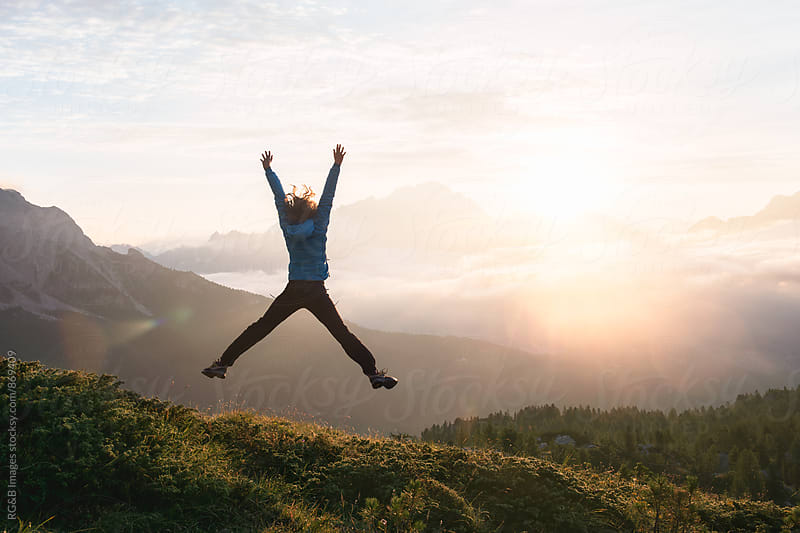 Woman jumping in the air at sunrise by RG&B Images for Stocksy United
