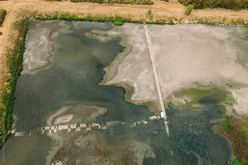 overhead view from a hot air balloon of a retention pond by Gillian Vann for Stocksy United