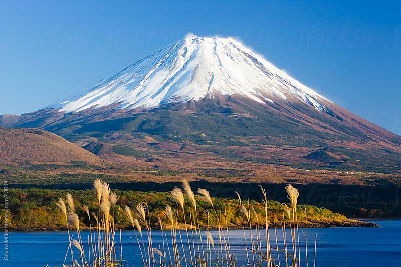 Japan, Central Honshu (Chubu), Fuji-Hakone-Izu National Park, Mount Fuji (3776m) snow capped and viewed across lake Motosu-ko in the Fuji Go-ko (five lakes) region by Gavin Hellier for Stocksy United