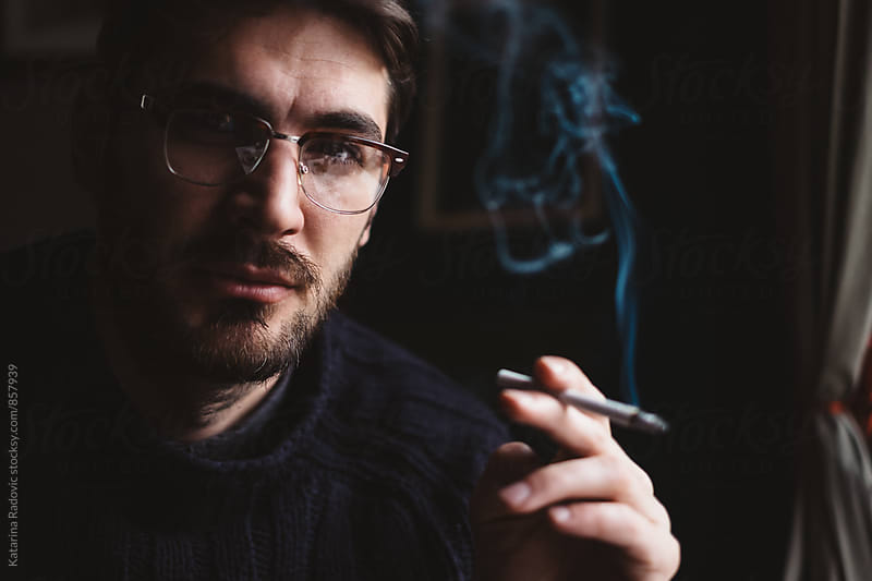 Portrait of a Handsome Man Smoking Cigarette by Katarina Radovic for Stocksy United