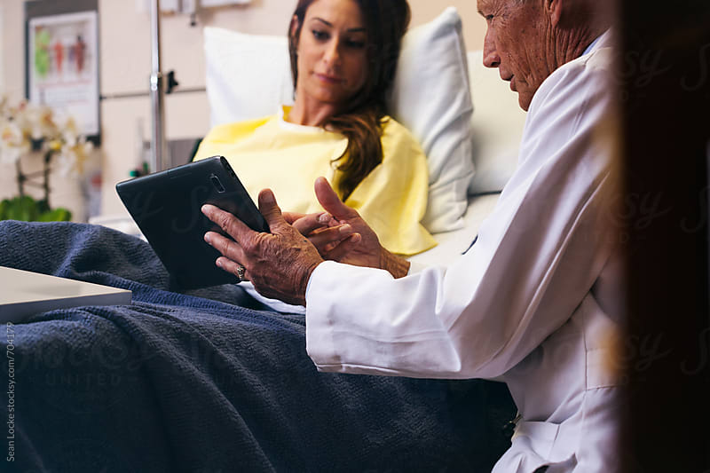Hospital: Focus On Digital Tablet Held By Physician by Sean Locke for Stocksy United