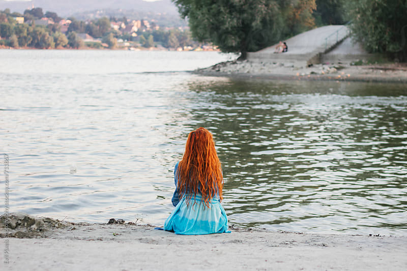 Portrait of a female redhead model from back on the river by Branislava Živić for Stocksy United