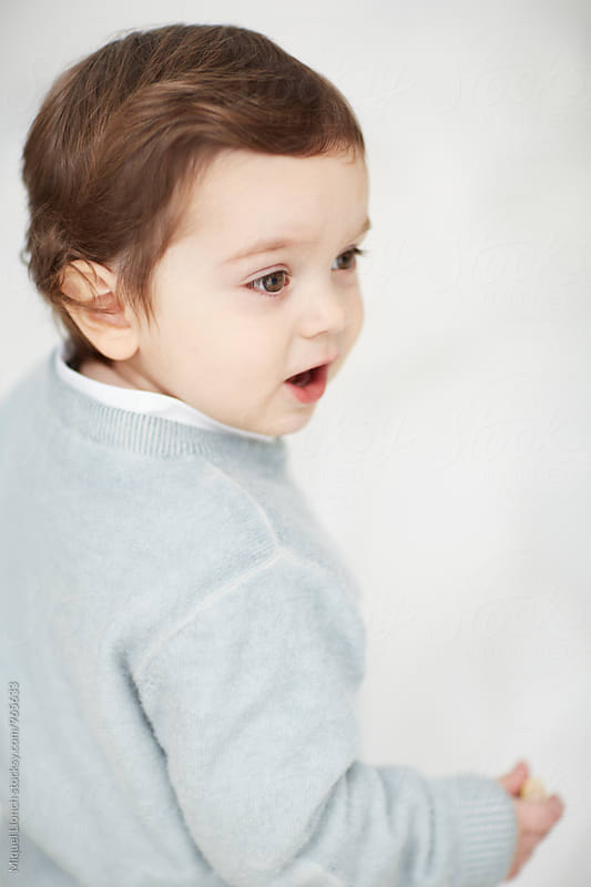 Portrait of a toddler with white background by Miquel Llonch for Stocksy United