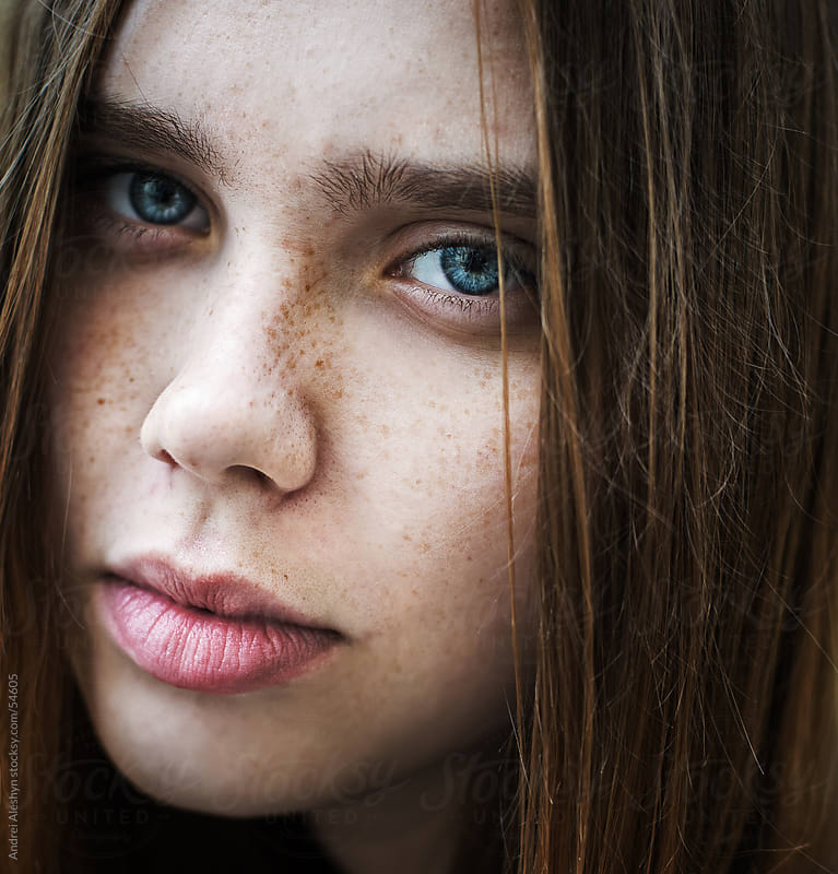 portrait of a beautiful young girl by Andrei Aleshyn for Stocksy United