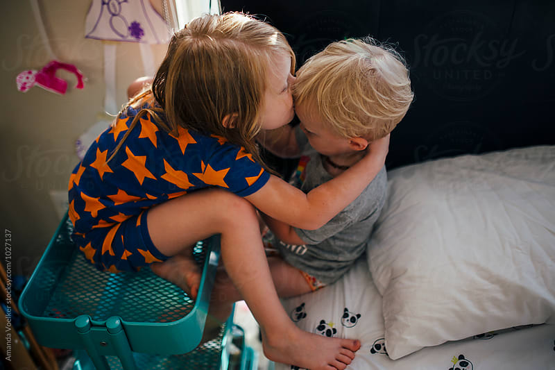 Birds Eye View of Two young Kids Hugging in their room by Amanda Voelker for Stocksy United