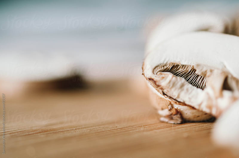 mushrooms sliced by Samantha Wesselhoft for Stocksy United