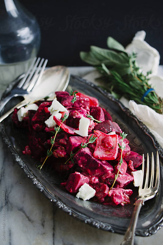 Roasted beetroot and feta salad. by Darren Muir for Stocksy United