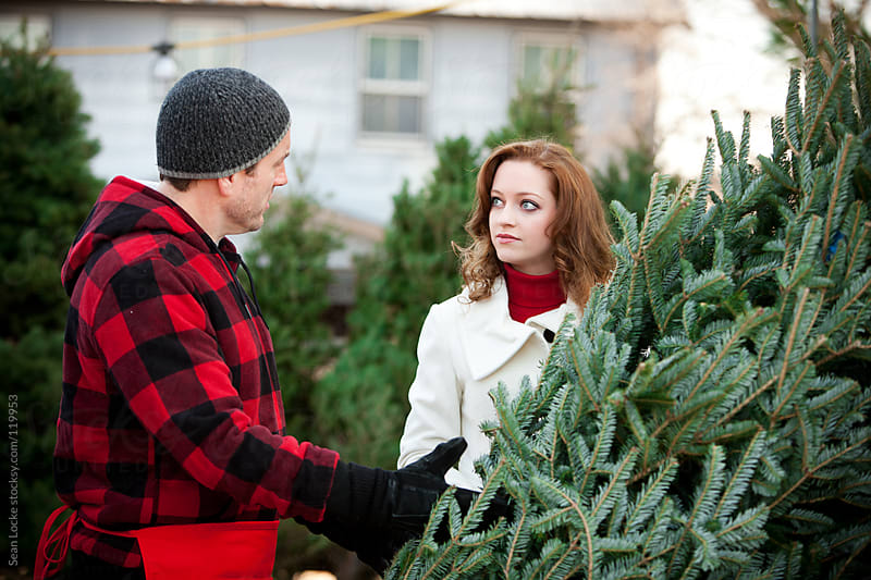 Tree Lot: Woman Discusses Tree with Employee by Sean Locke for Stocksy United