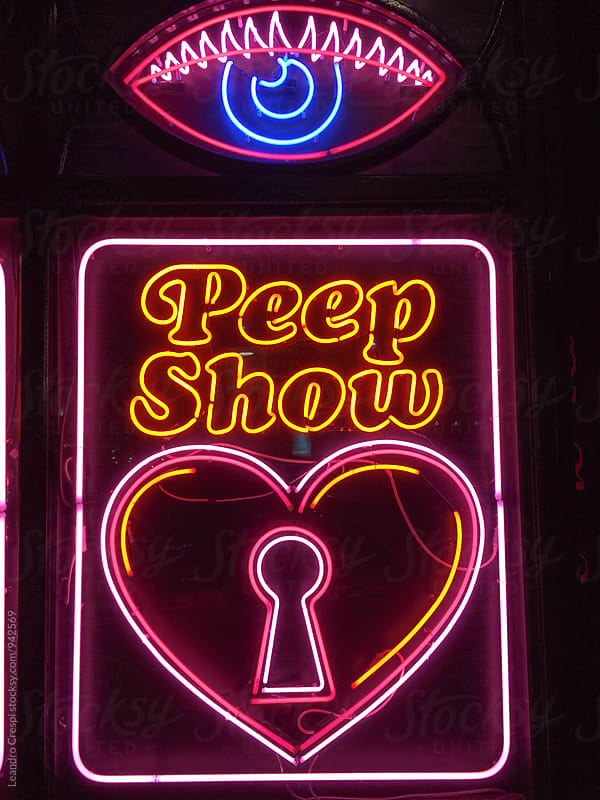 Neon signs lit at night by Leandro Crespi for Stocksy United