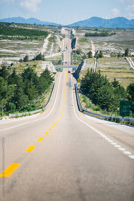 View of a long road - highway in the countryside by Alejandro Moreno de Carlos for Stocksy United