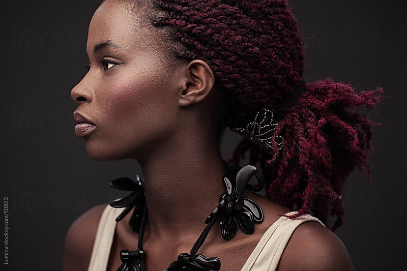 African Woman With Pink Dreadlocks by Lumina for Stocksy United