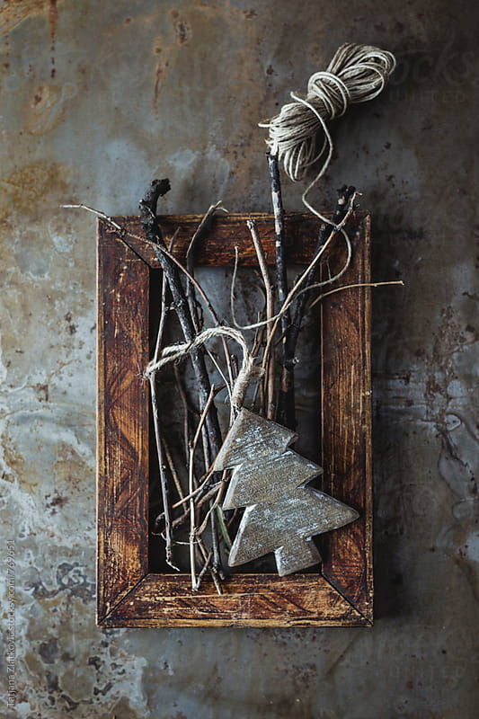 Christmas ornament and twigs by Tatjana Ristanic for Stocksy United