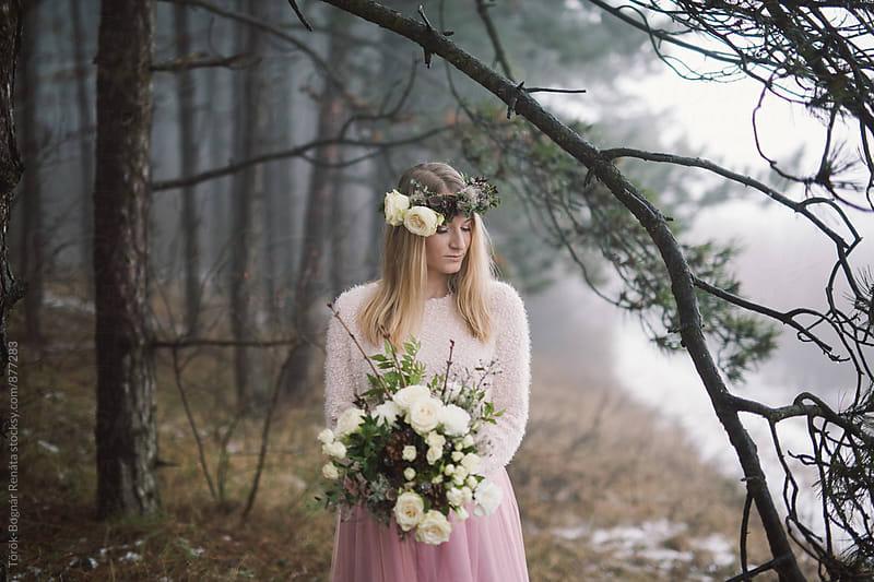 Beautiful blonde woman in the foggy pine woods by Török-Bognár Renáta for Stocksy United