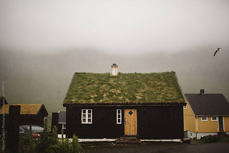 Dreary Grass Roof Houses in the Faroe Islands by Rachel Gulotta Photography for Stocksy United