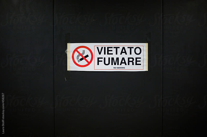 No smoking sign and write home printed on elevator metal wall by Laura Stolfi for Stocksy United