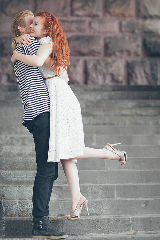 Couple Hugging on the Stairs by Lumina for Stocksy United