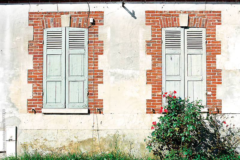 two windows with closed shutters by Léa Jones for Stocksy United