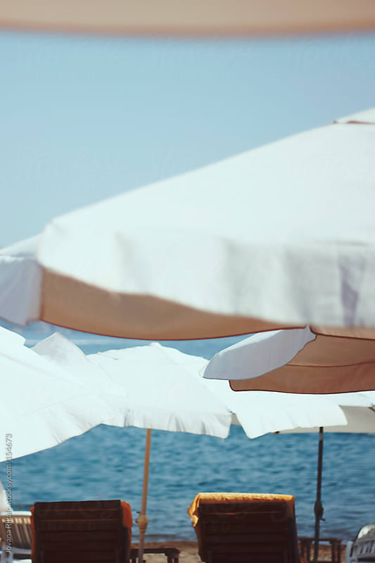 Two sunbeds on the beach by Jovana Rikalo for Stocksy United