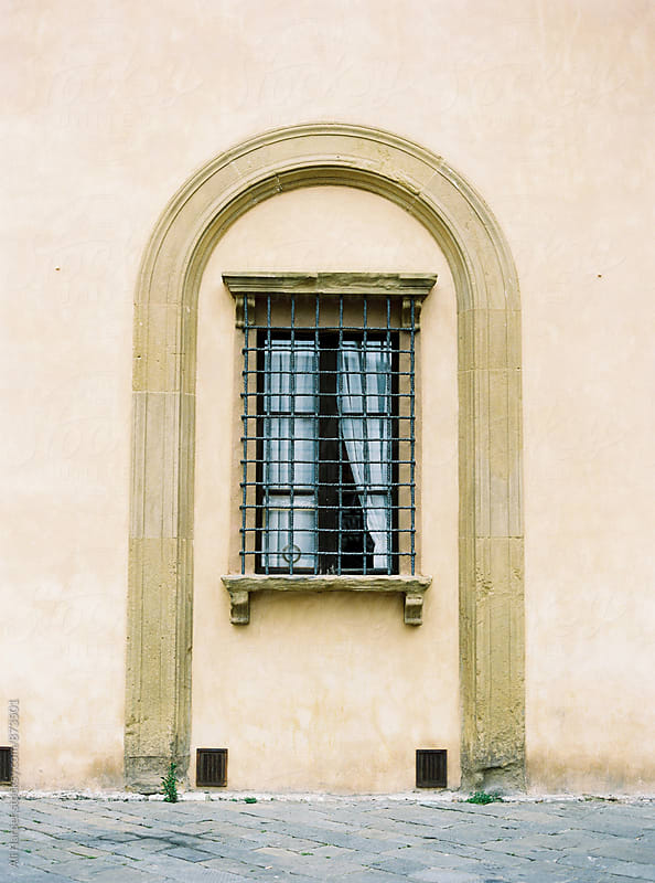 Siena window by Ali Harper for Stocksy United