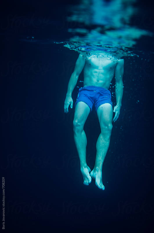 Young muscular man swimming in the sea by Boris Jovanovic for Stocksy United