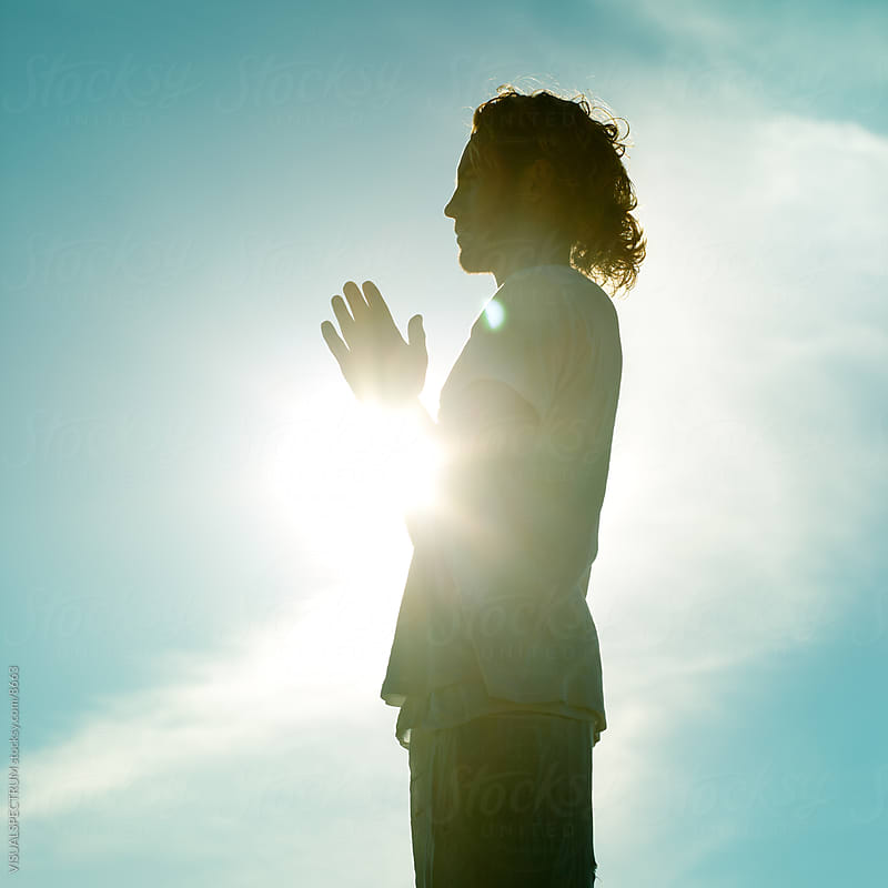 Praying Young Man by VISUALSPECTRUM for Stocksy United