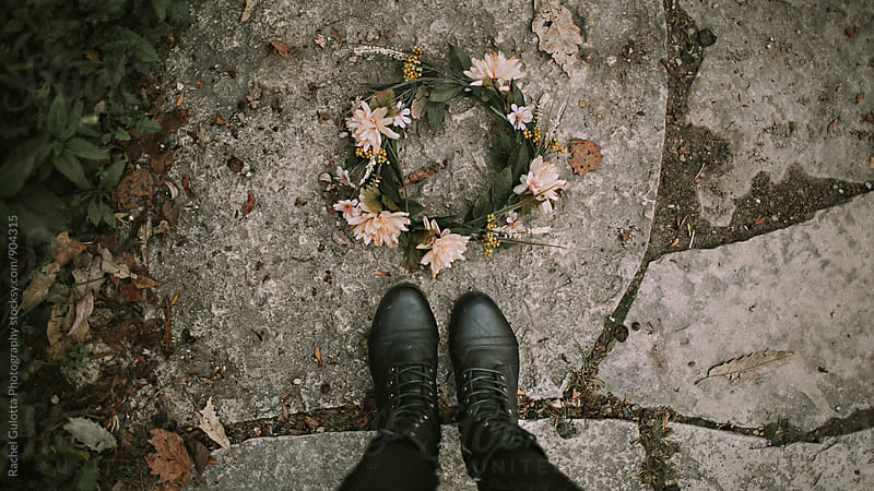 Boots on Ground in Front of Floral Crown by Rachel Gulotta Photography for Stocksy United