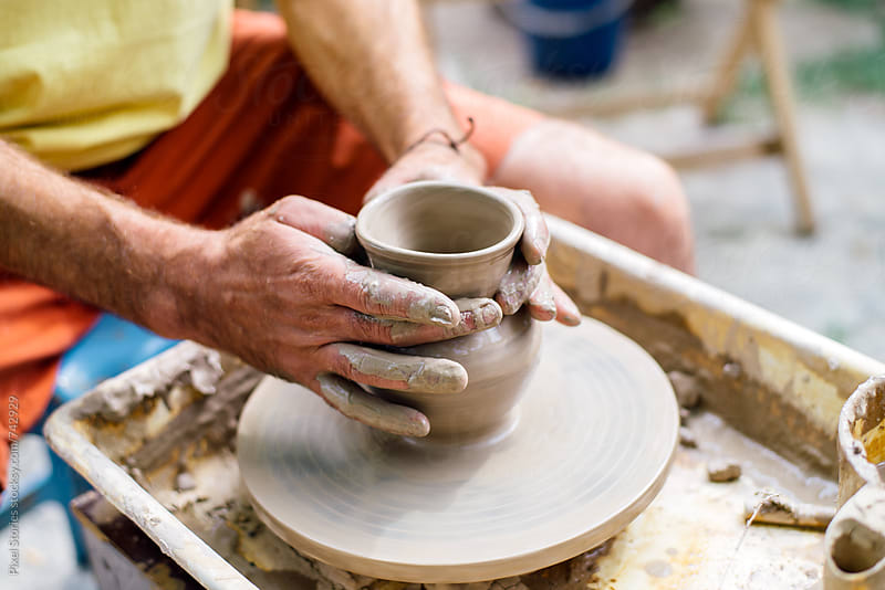 Skillful potter shaping clay by Pixel Stories for Stocksy United