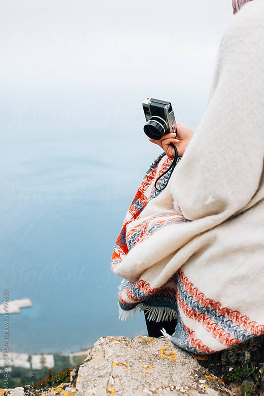 Close Up of Woman Sitting on Island Viewpoint and Holding Old-Fashioned Rangefinder Camera by VISUALSPECTRUM for Stocksy United