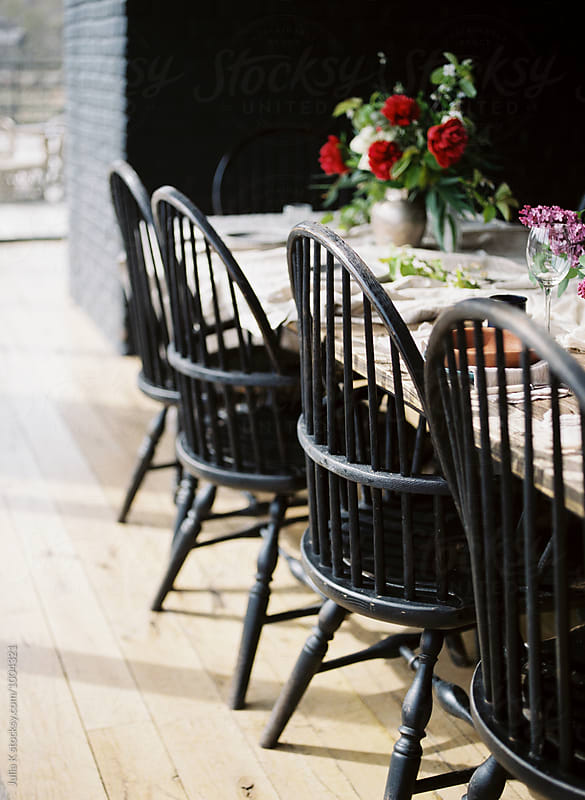 Chairs in  a restaurant by Julia Kaptelova for Stocksy United