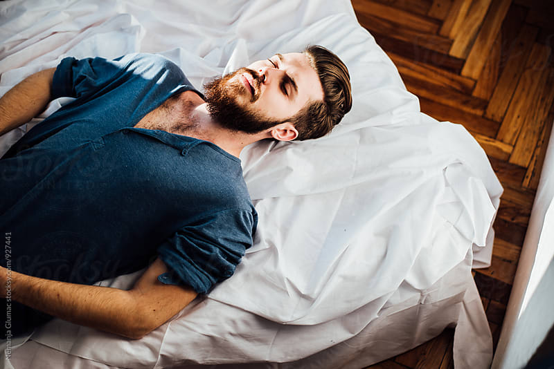 Handsome Bearded Man laying on Bed  by Nemanja Glumac for Stocksy United