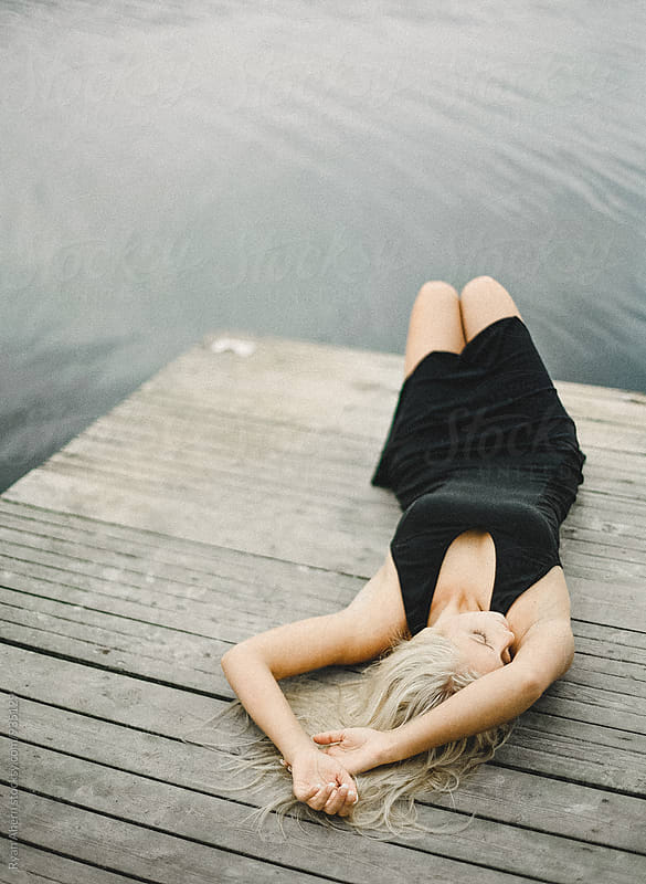 Swedish Girl with a Jetty on a Lake by Ryan Ahern for Stocksy United