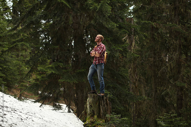 Hiker standing on stump by Milles Studio for Stocksy United