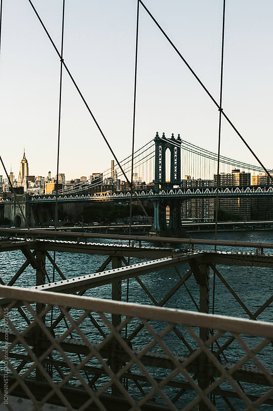 Views of Manhattan bridge from Brooklyn bridge. by BONNINSTUDIO for Stocksy United
