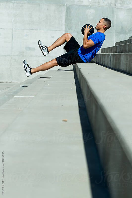 Young man fitness training outdoors by ZOA PHOTO for Stocksy United