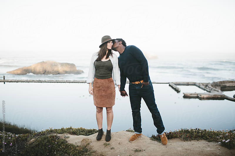 beautiful fashionable couple together outside in california by Nicole Mason for Stocksy United