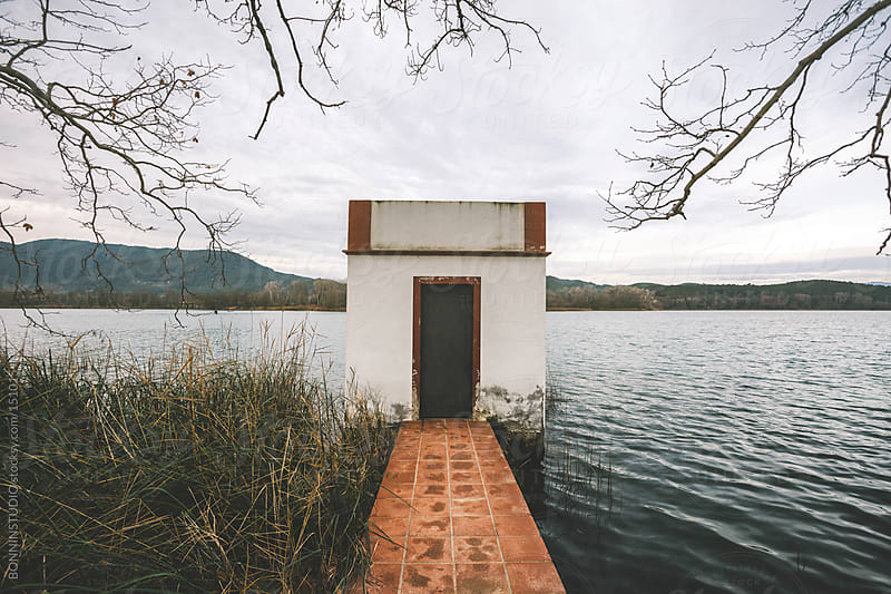 Typical floating house at Banyoles Lake, Spain by BONNINSTUDIO for Stocksy United