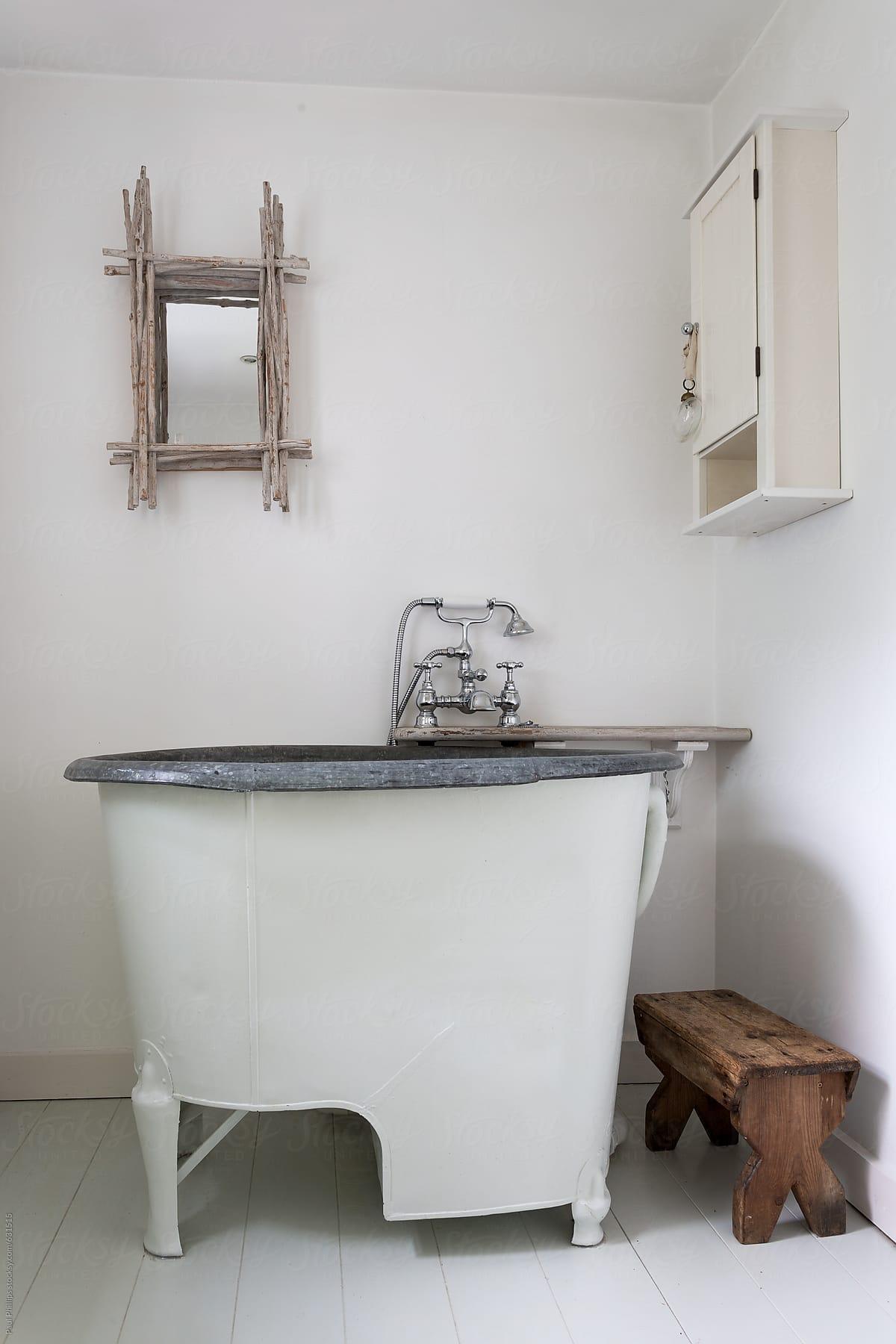 Antique Tin Tub In A Bathroom Setting | Stocksy United