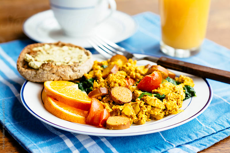 Tofu Scramble with Spinach, Tofu Hot Dogs and Cherry Tomatoes  by Harald Walker for Stocksy United