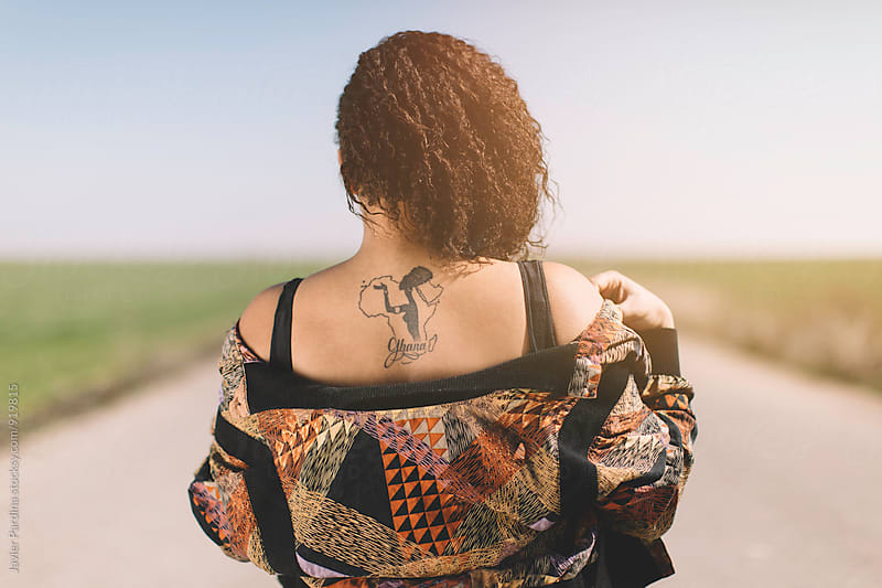 tattoo on the back black woman by Javier Pardina for Stocksy United