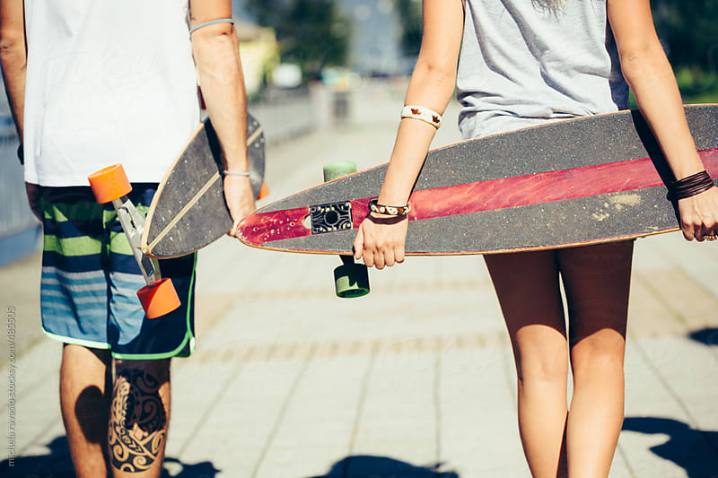 Skaters holding their longboards by michela ravasio for Stocksy United