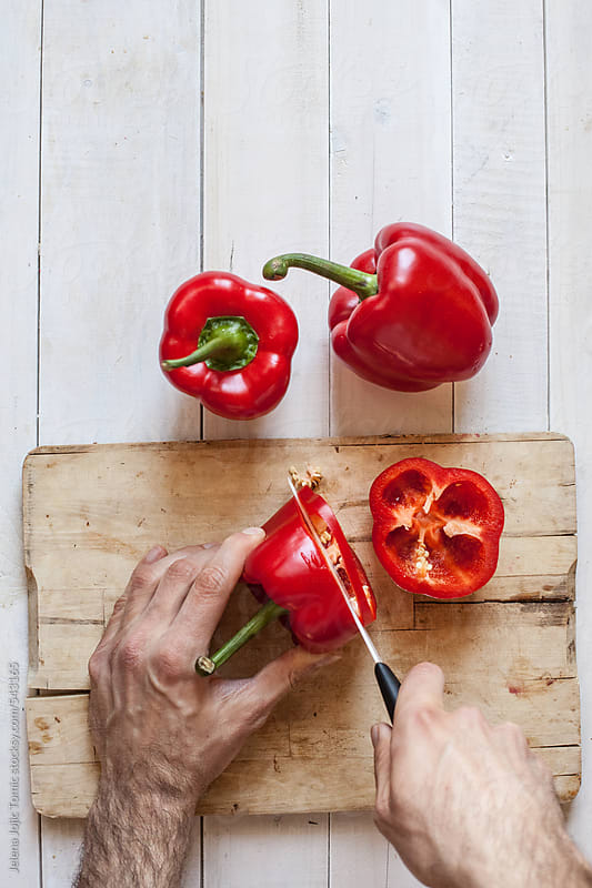 Cutting peppers by Jelena Jojic Tomic for Stocksy United
