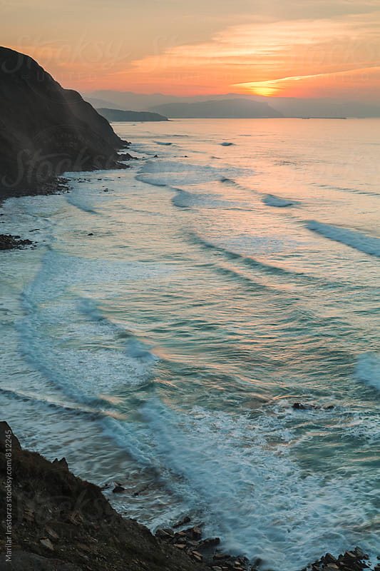 Sunset on the coastline of northern Spain by Marilar Irastorza for Stocksy United