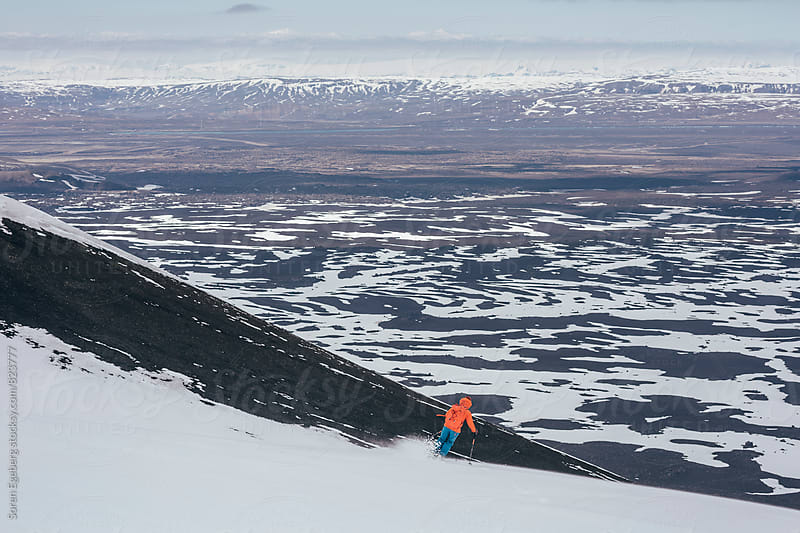 Young female skier descending Mt. Hekla in Iceland by Soren Egeberg for Stocksy United