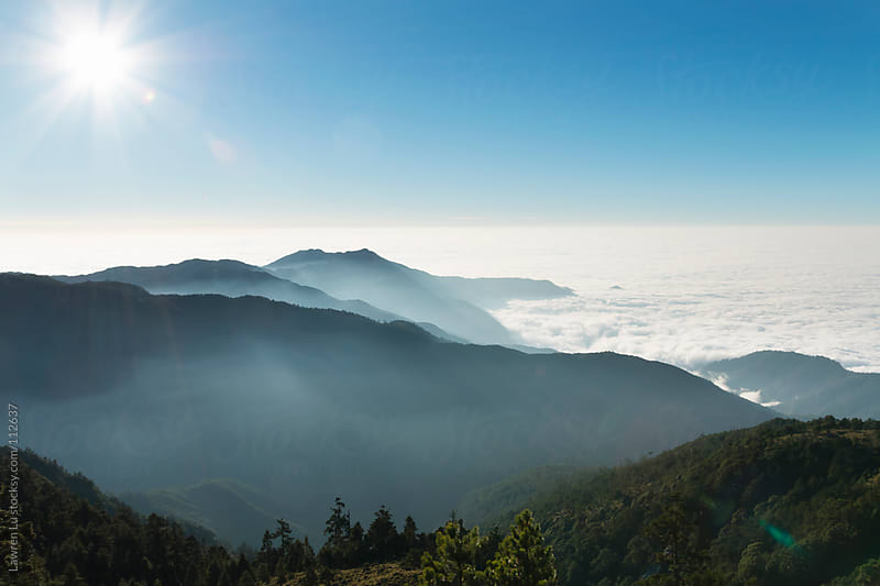Sunrise form mountians with beautiful clouds by Lawren Lu for Stocksy United
