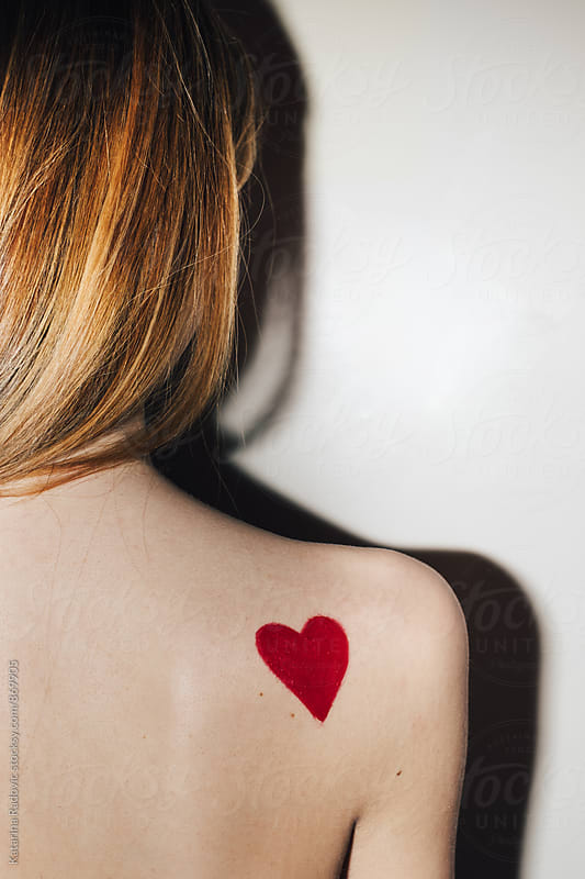 Red Heart Drawing on the Female Shoulder by Katarina Radovic for Stocksy United