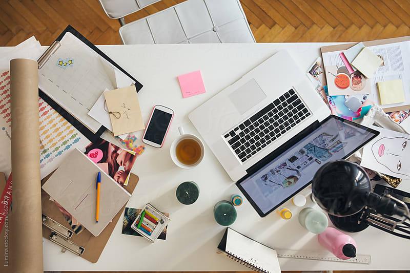 Modern Businesswoman's Messy Desk  by Lumina for Stocksy United